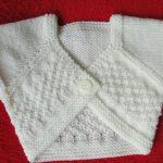 Cache coeur bébé tricot